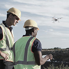 Surveyors in the field performing a mapping mission using a md4-1000 UAV
