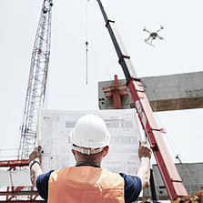 Architect inspecting a construction site with the help of a Microdrones UAV