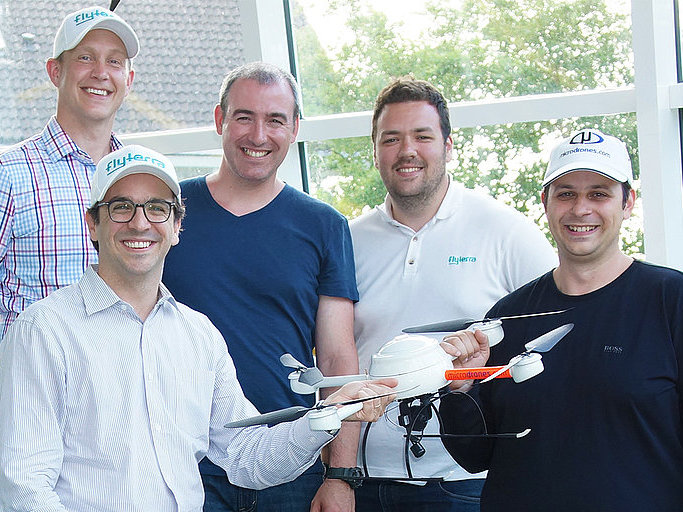 The teams of Microdrones and Avyon holding a md4-200 UAV.