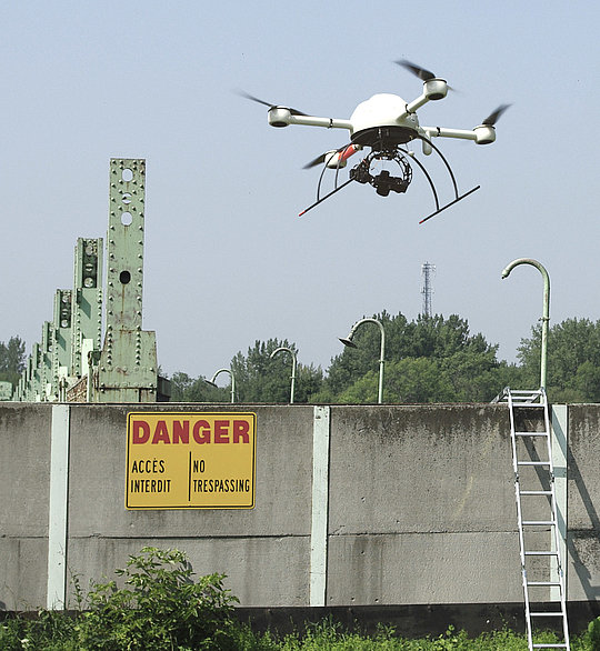 Surveying specialists inspecting a dilapidated damn with a Microdrones md4-1000 UAV