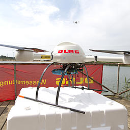 A Microdrones md4-1000 UAV equipped with a Restube water rescue device shown during a emergency simulation