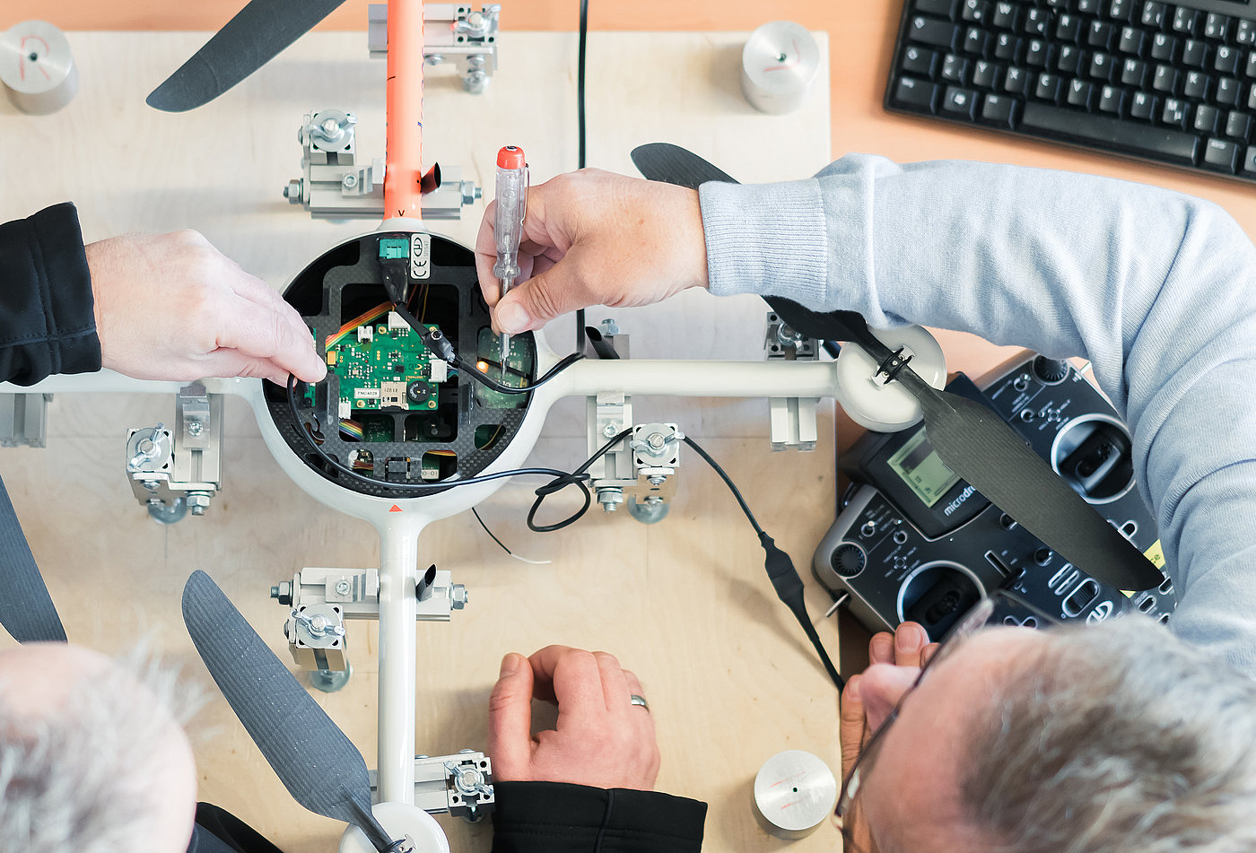 Microdrones engineers preparing md4-200 electronics for new mission